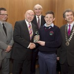 Cathal Dervan, member of the judging committee; Minister for Education, Ruairi Quinn, TD; Matt Dempsey, Chairman NNI; Aaron Amond, Presentation College, Carlow, 1st place Sport category; Martin Sisk, President, Irish League of Credit Unions