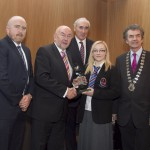 Darragh Keany, member of the judging committee; Minister for Education, Ruairi Quinn, TD; Matt Dempsey, Chairman NNI; Emily O'Grady, Colaiste Chiarain, Croom, Co. Limerick, 1st Features category; Martin Sisk, President, Irish League of Credit Unions