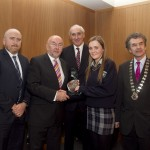 Darragh Keany, member of the judging committee; Minister for Education, Ruairi Quinn, TD; Matt Dempsey, Chairman NNI; Zoe De Gogan, Pobalscoil na Trionoide, Gaelscoil na Trionoide, Co Corcaigh, 2nd place Features category; Martin Sisk, President, Irish League of Credit Unions